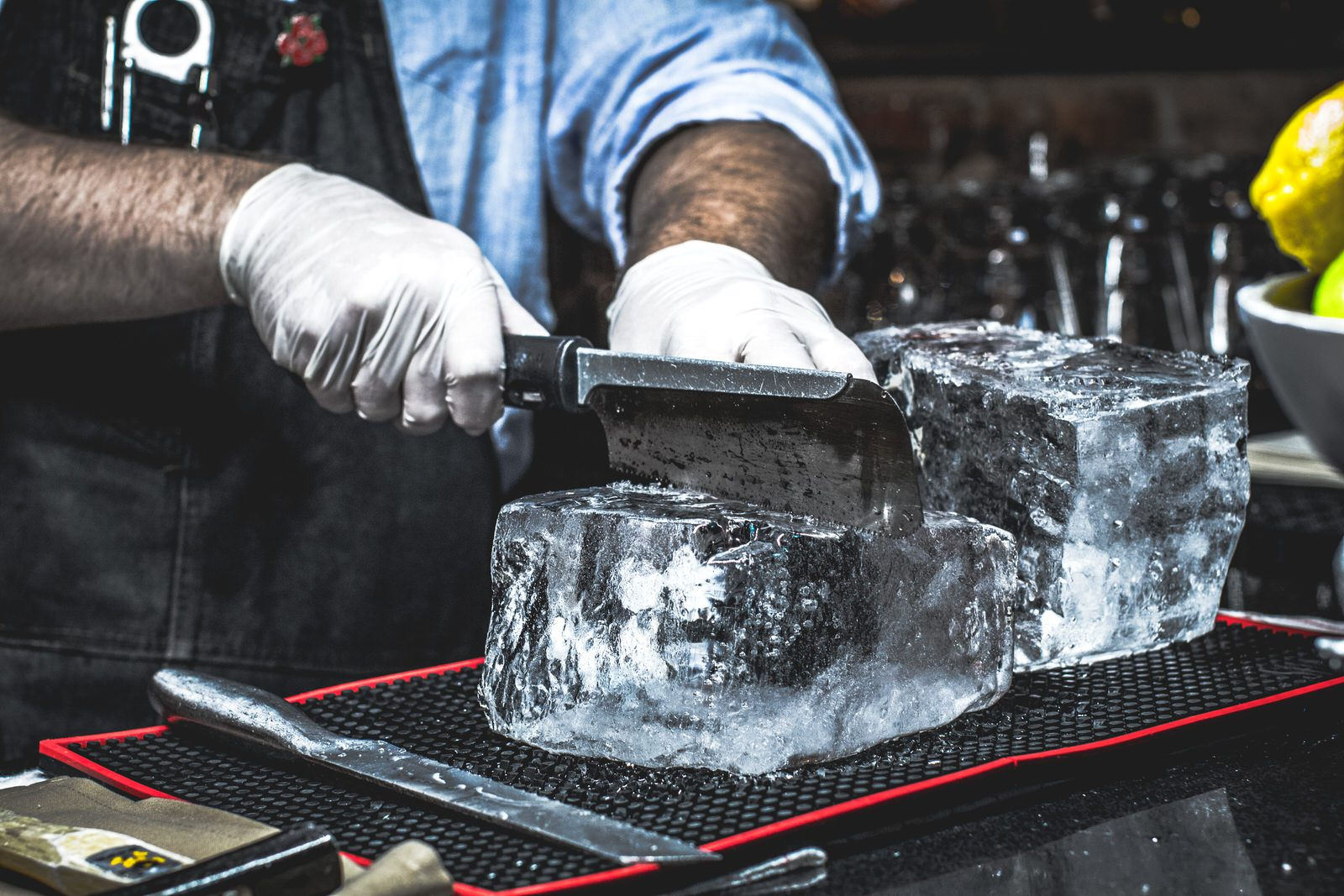 block of ice being cut to perfection by 13 Prime Steak associate in Clovis, Ca